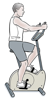 Man exercising on stationary bike.