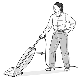 Woman pulling vacuum cleaner towards herself.